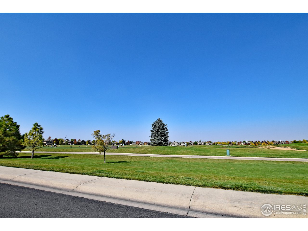 Front of building is directly across the street from the driving range! Steps to world class golfing!