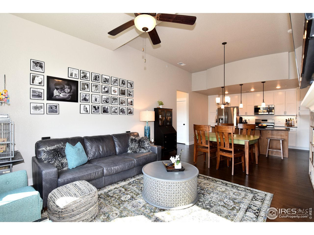 Spacious great room w/ views back to kitchen and dining space ALL upgraded engineered hardwood on main level!
