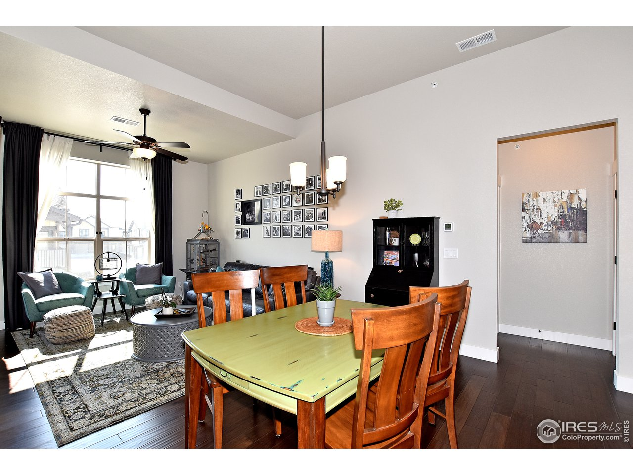 Ample space in the dining room right off of kitchen and engineered hardwood throughout main level!