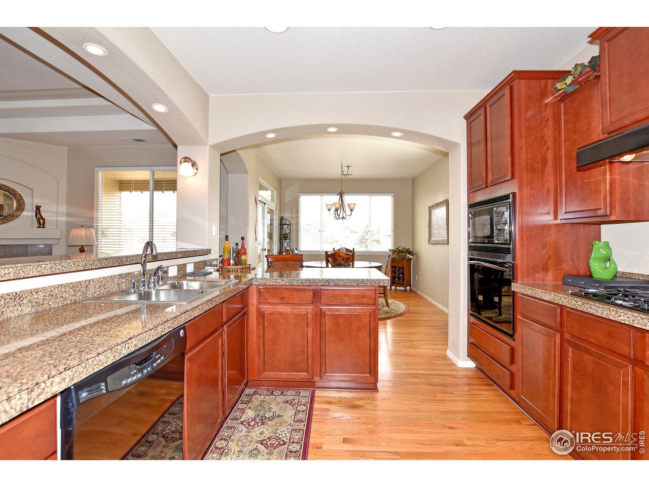 Hardwood floors in kitchen and dining areas