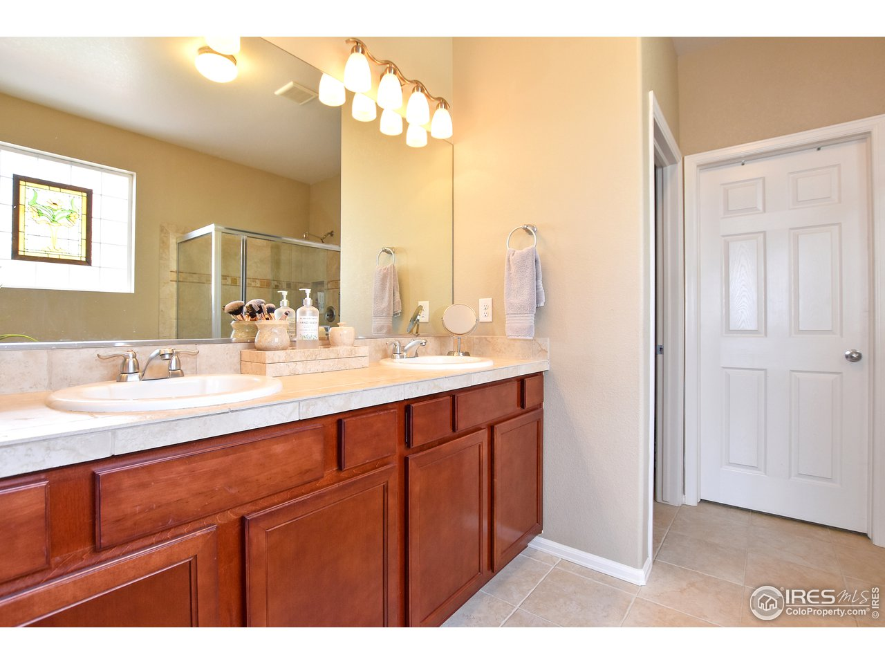 Double vanity and tile floors!