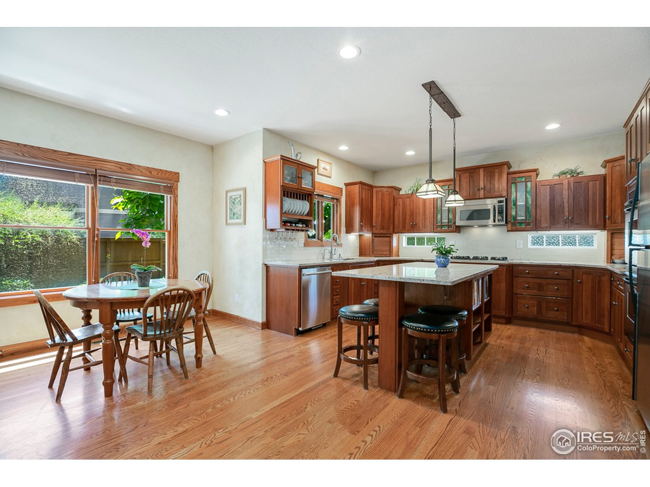 Spacious chef's kitchen with Schroll cabinetry and newer granite