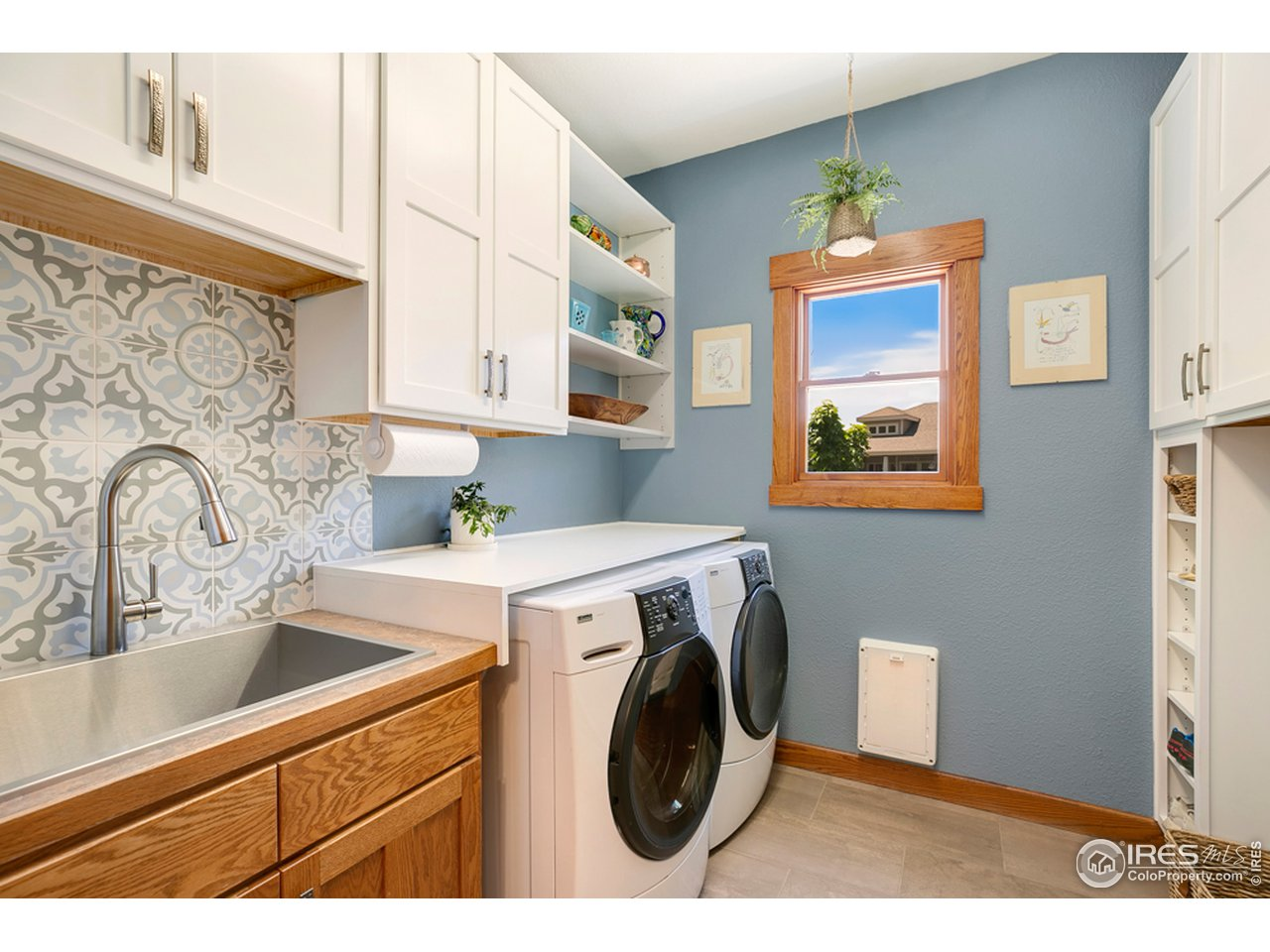 Recently updated laundry room close to garage and loads of builtins!