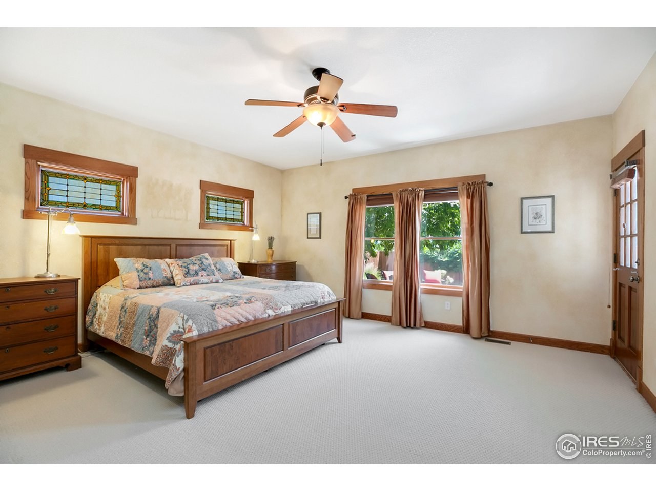 Spacious main floor master bedroom with exterior door to covered patio