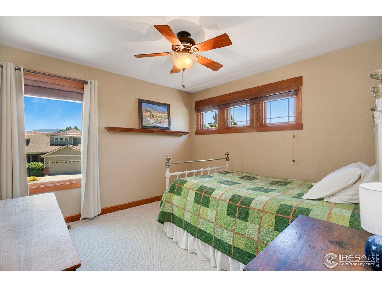 2nd bedroom upstairs look at those great wood windows!