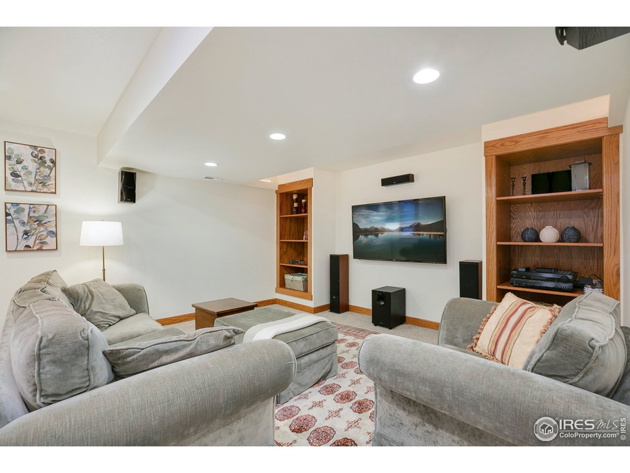 Media room with great built in book cases and equipped with surround sound
