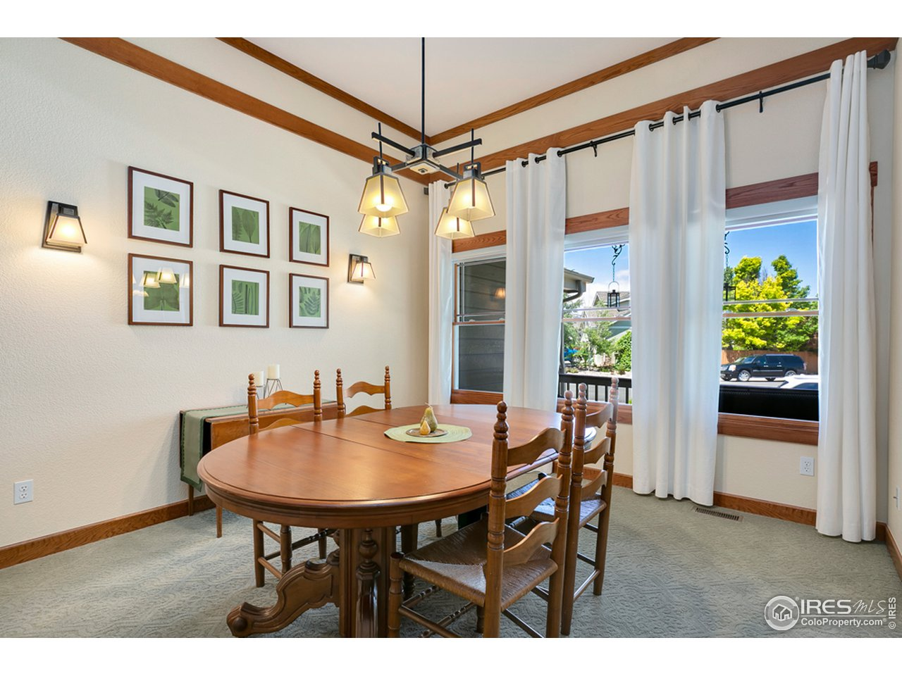 Formal dining with crown molding detail and tray ceilings