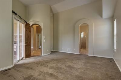 Master bedroom w/ sliding glass door to patio - see thru fireplace