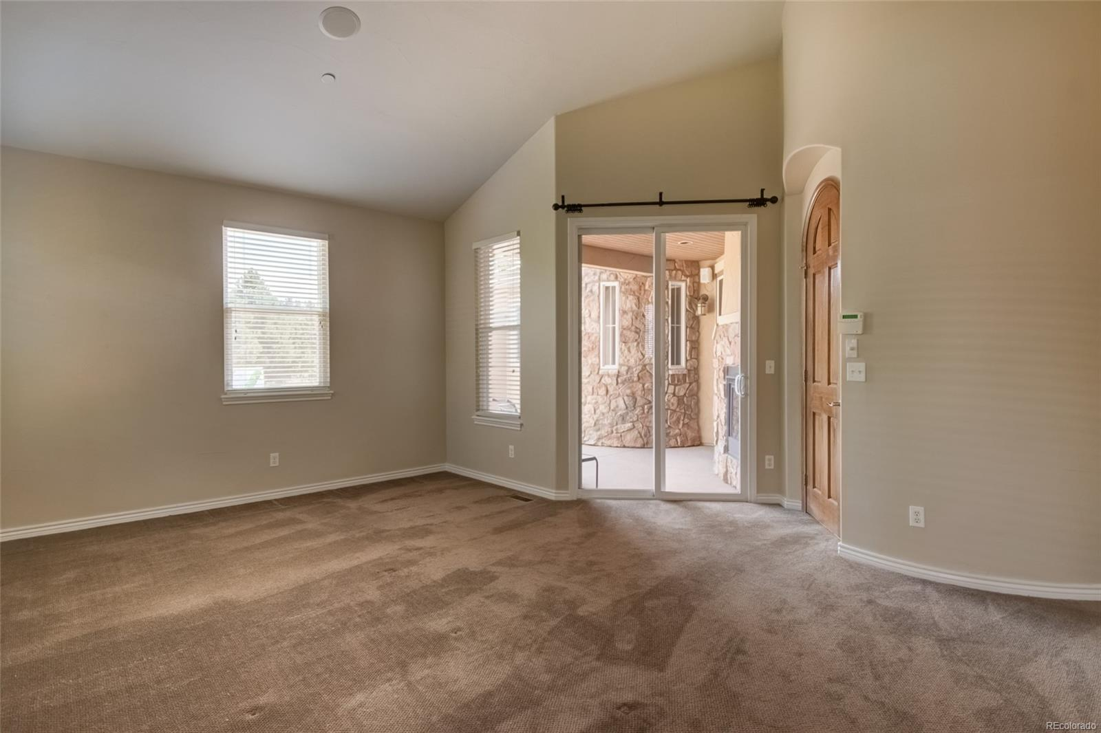 View of patio w/ see thru fireplace from master bedroom