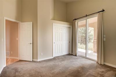 Second bedroom w/ access to back patio thru glass door