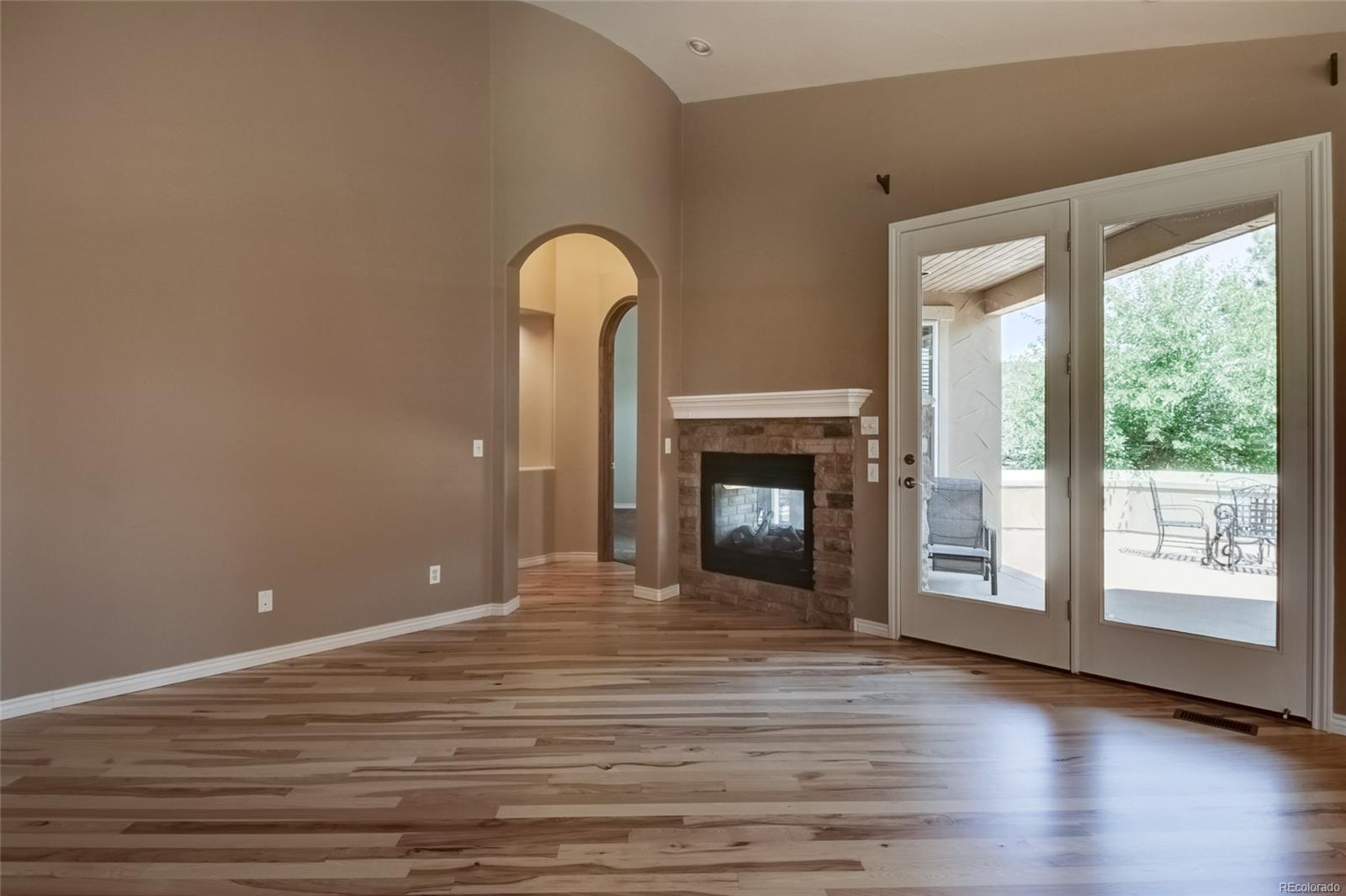 Access to front patio via glass doors from family room w/ 2 sided fireplace.