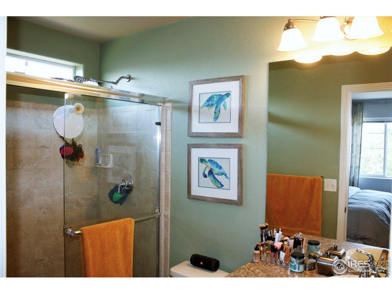 En-Suite Bathroom with tiled shower