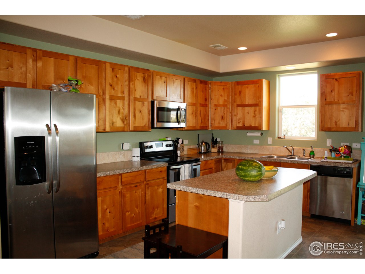 Kitchen with SS appliances and Knotty Alder cabinets