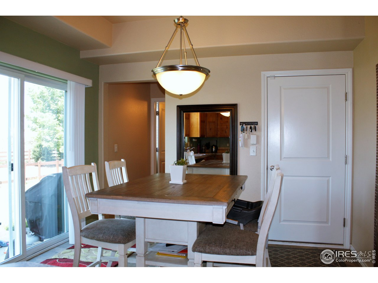 Dining room off of kitchen with garage door to right