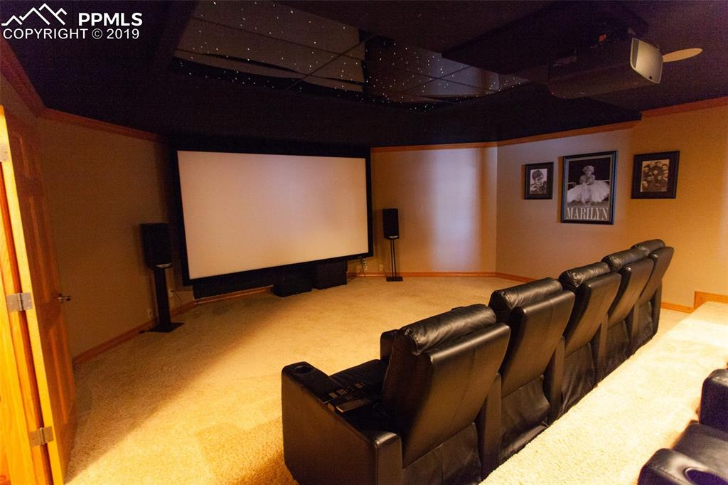 Massive home theater with large screen, 4k projector, and 7.2 surround sound