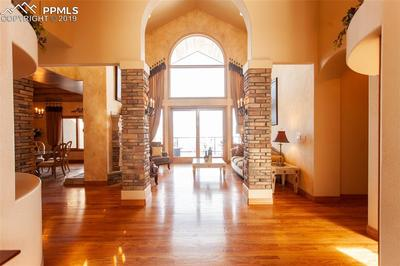 Entry with stone columns and high ceilings