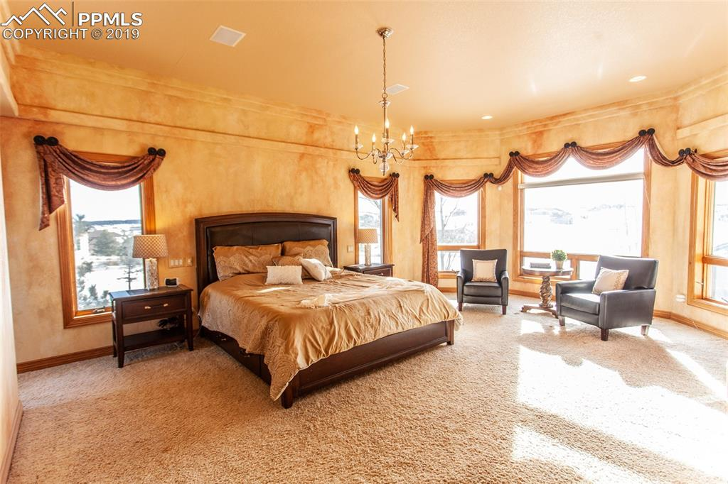 Spacious master bedroom with designer paint and extra space for seating