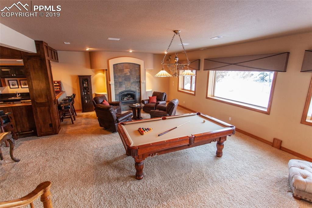 Basement family room with included pool table
