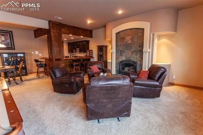 large sitting area with stunning stone fireplace