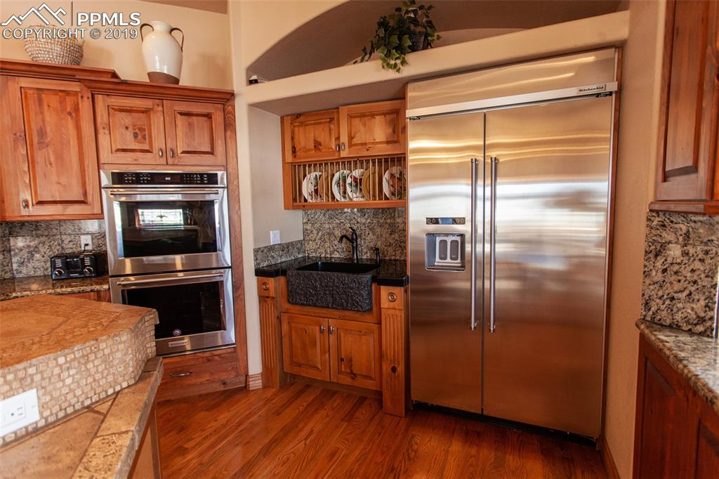 Large built in refrigerator, double ovens and second sink