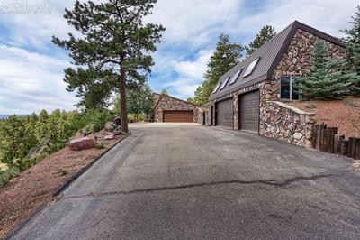 Paved driveway to detached over sized 3 car garage with work shop and wood burni