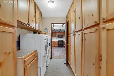 Large walk in pantry, utility sink, washer and dryer.