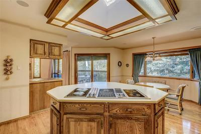 Multiple-use cooktop -- skylight provides plenty of light