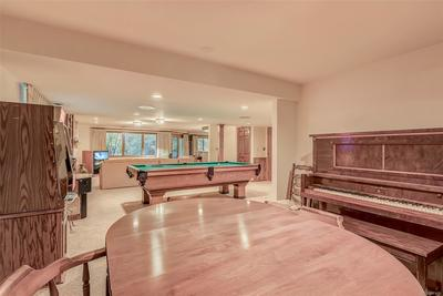 Looking from game table to pool table to 2nd family room -- huge space!