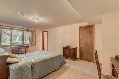 Lower-level bedroom with walk-in closet & en-suite bath