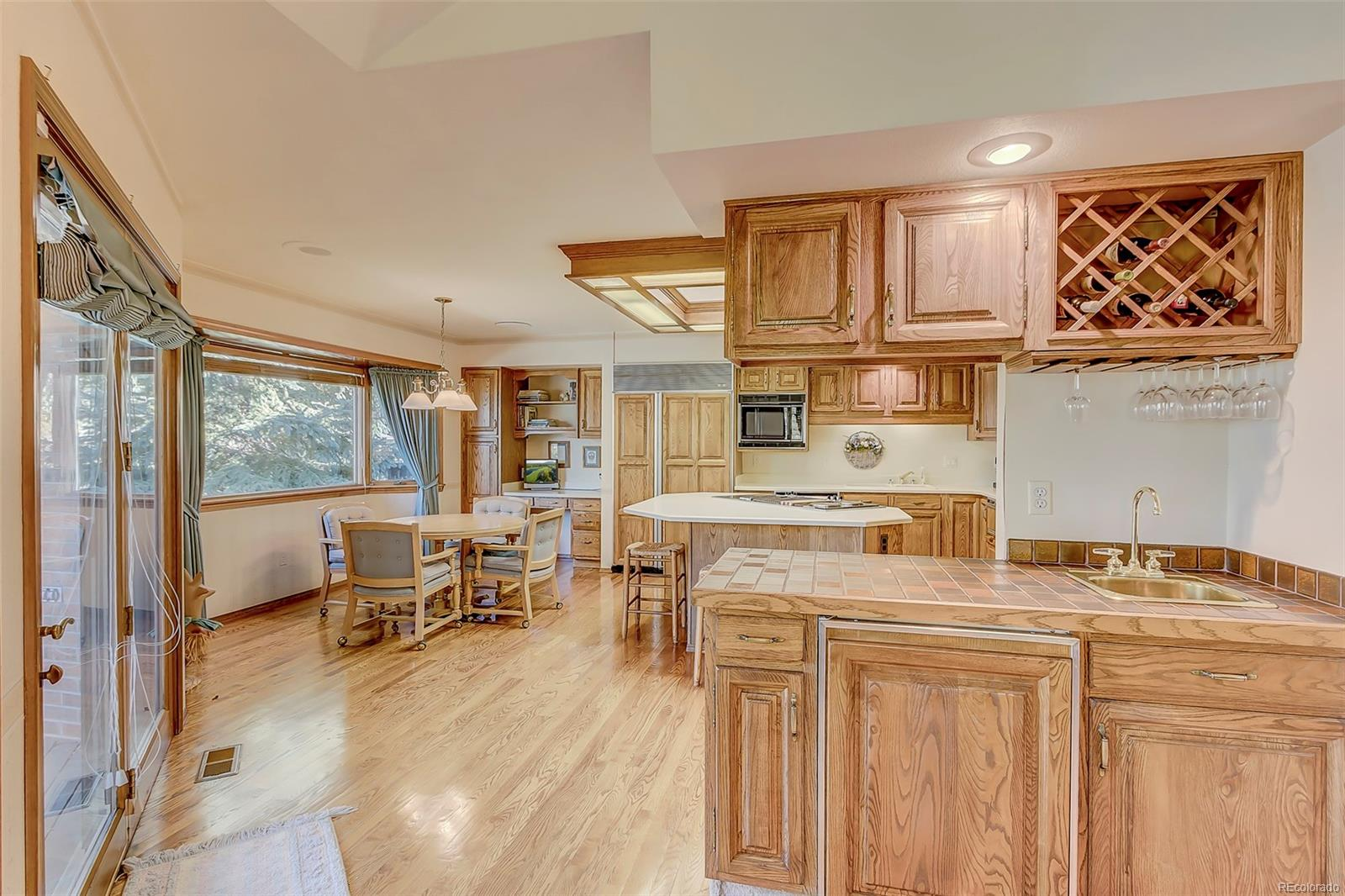 Wet bar, deck access & kitchen are adjacent to family room