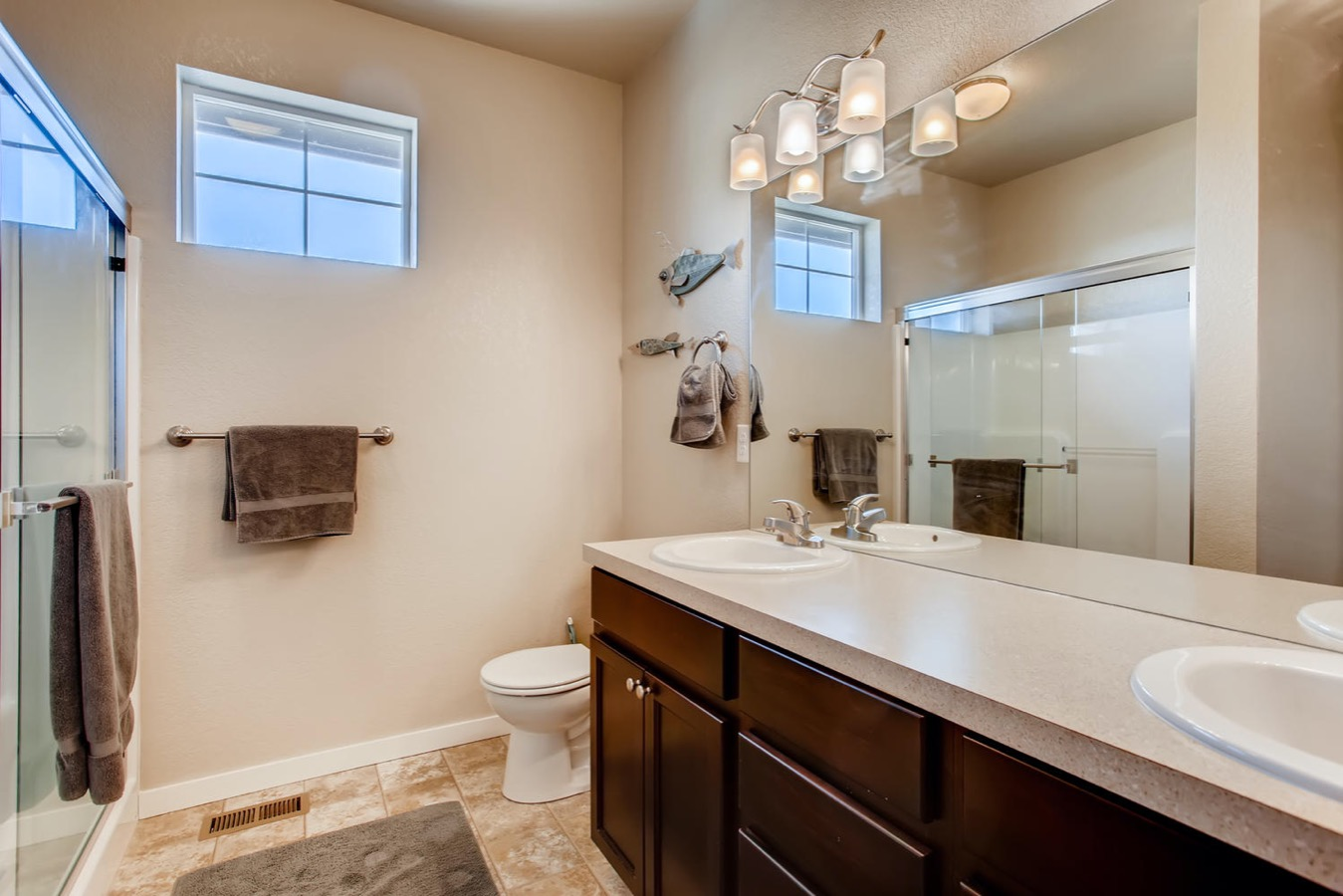 Master bathroom with double sinks & natural light