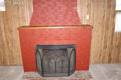 Dominating wood burner downstairs in family room.