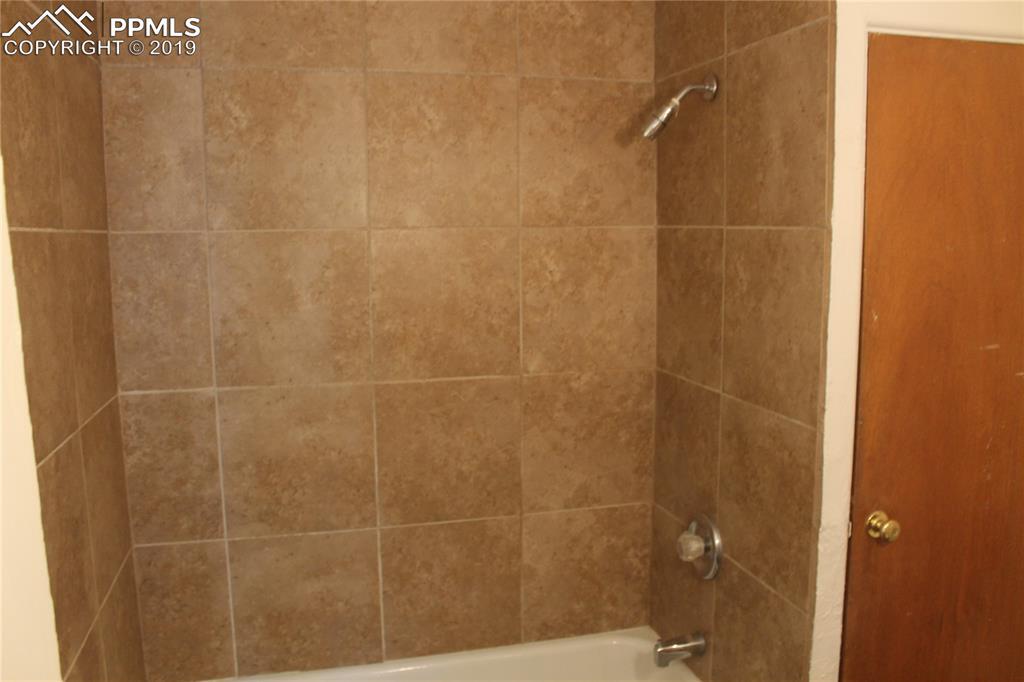 Upstairs bathroom has new tile surround,