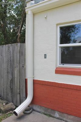 Large cylindrical gutters give the structure a 50's vibe.