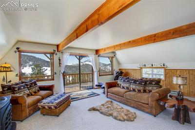 Spacious Living Room with Walk Out Deck!