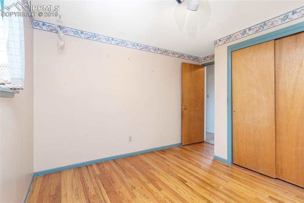 Large first bedroom with amazing original hardwood floor!