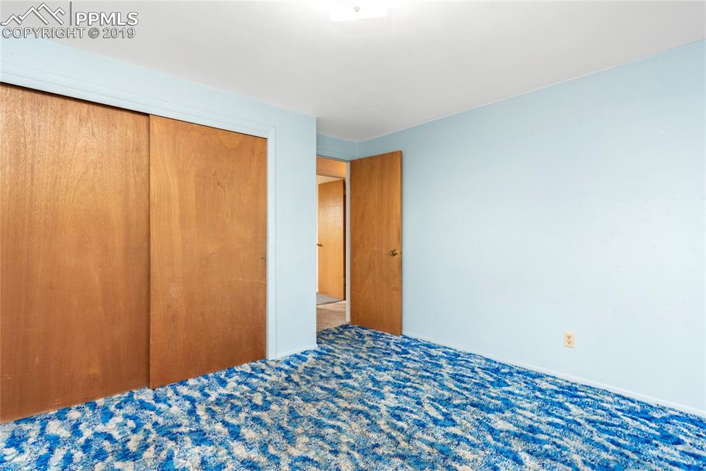 Second bedroom with hardwood floor hiding underneath!