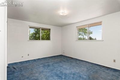 Large master bedroom with hardwood underneath the carpet!