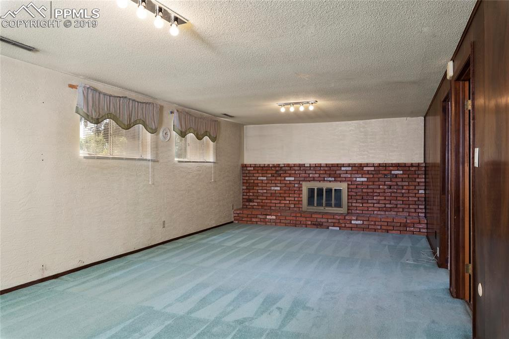 Huge family room downstairs with full-wall fireplace firebrick hearth!