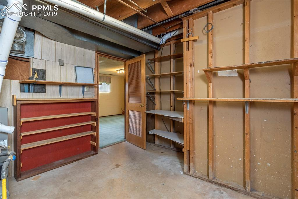 Large laundry/utility room with lots of storage!