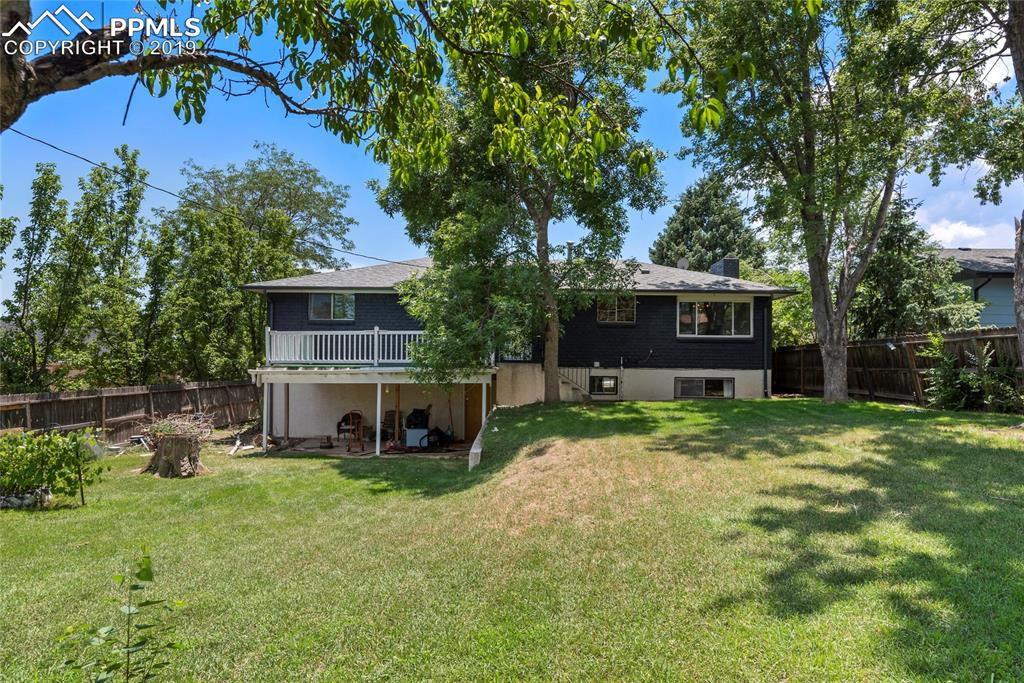 Lovely deck and lower patio, mature grass and landscaping!