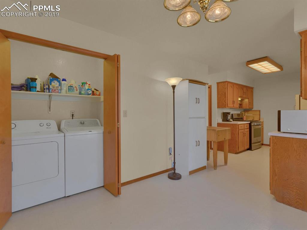 Laundry room includes clothes washer and dryer for everyday convenience
