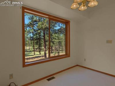 Dining Nook in kitchen.....Look at the whispering pines
