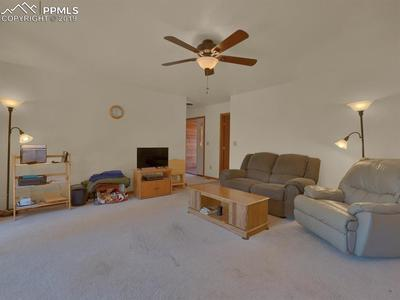 Living room is large and cozy in a well maintained home