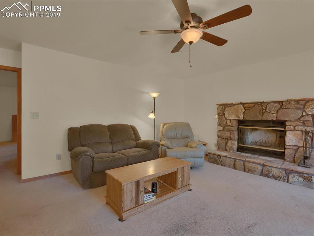 Moss Rock fireplace, natural stone provides heat and ambiance