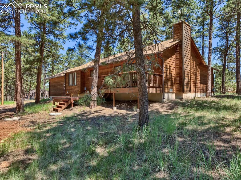 2 bedroom 2 bath home is nestled in the pines with a natural setting on a level lot