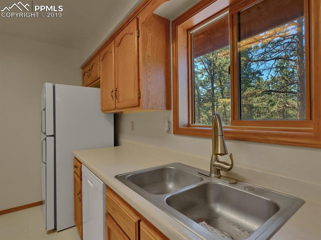 Kitchen with all appliances/ Wooded views