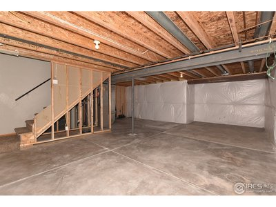 Basement insulated wall area adjoining laundry