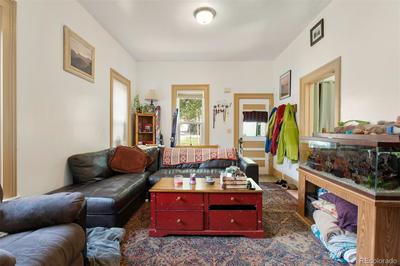 SW Corner; back of SFR unit 1501 and 4 storage units accessible from back alley or backyard