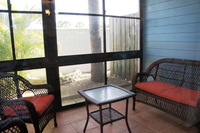 Screened Porch opens to green area